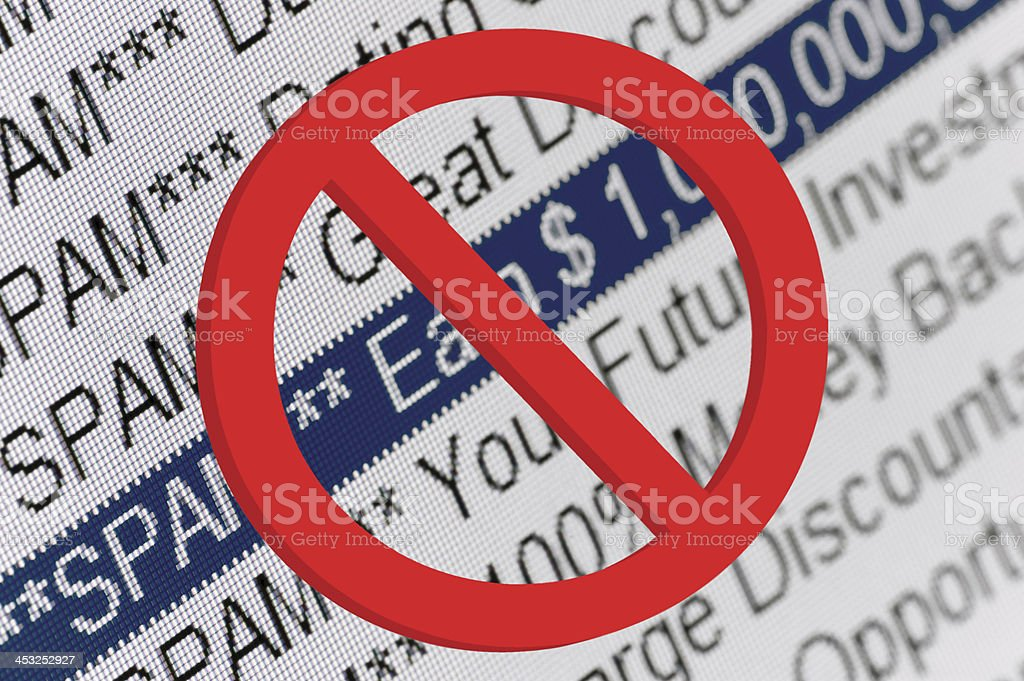 Spam Folder Listing And Red Prohibition Sign Macro Closeup stock photo