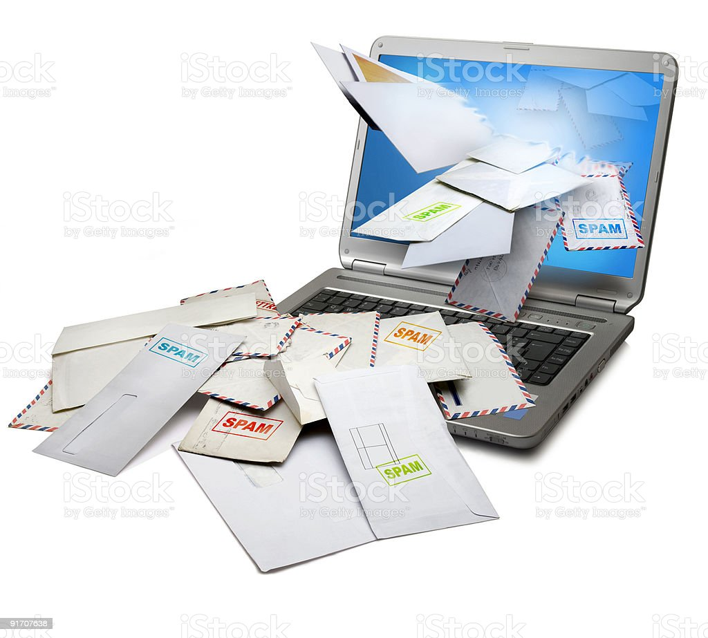 Spam letters flying through a laptop stock photo