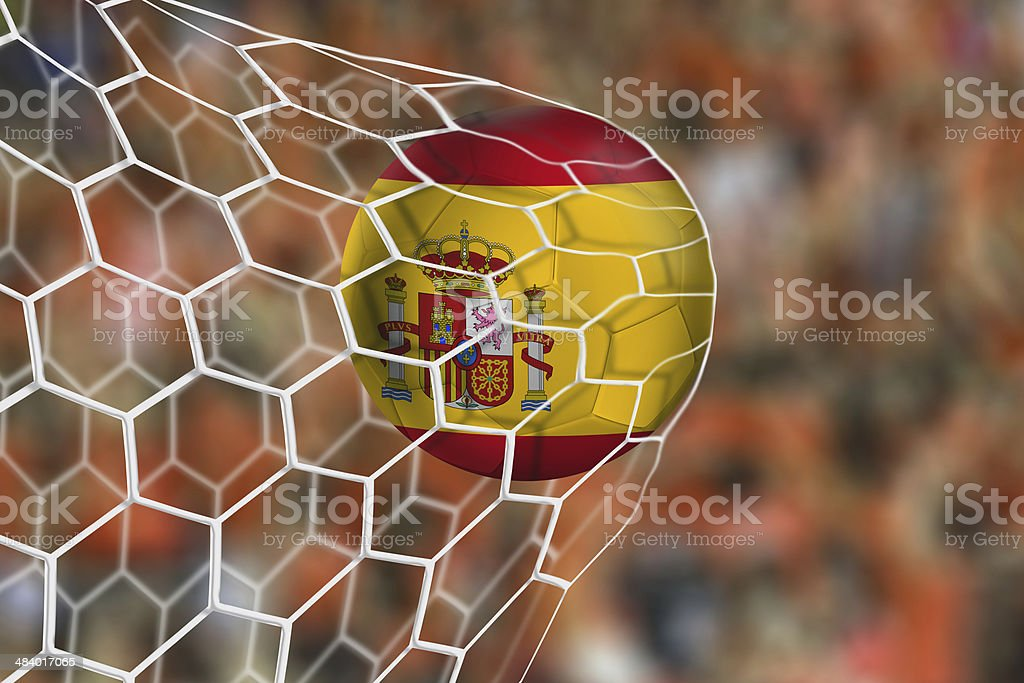 Spanish ball flies into the net game stock photo