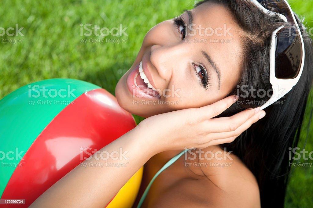 Spanish bikini beauty holding beach ball royalty-free stock photo