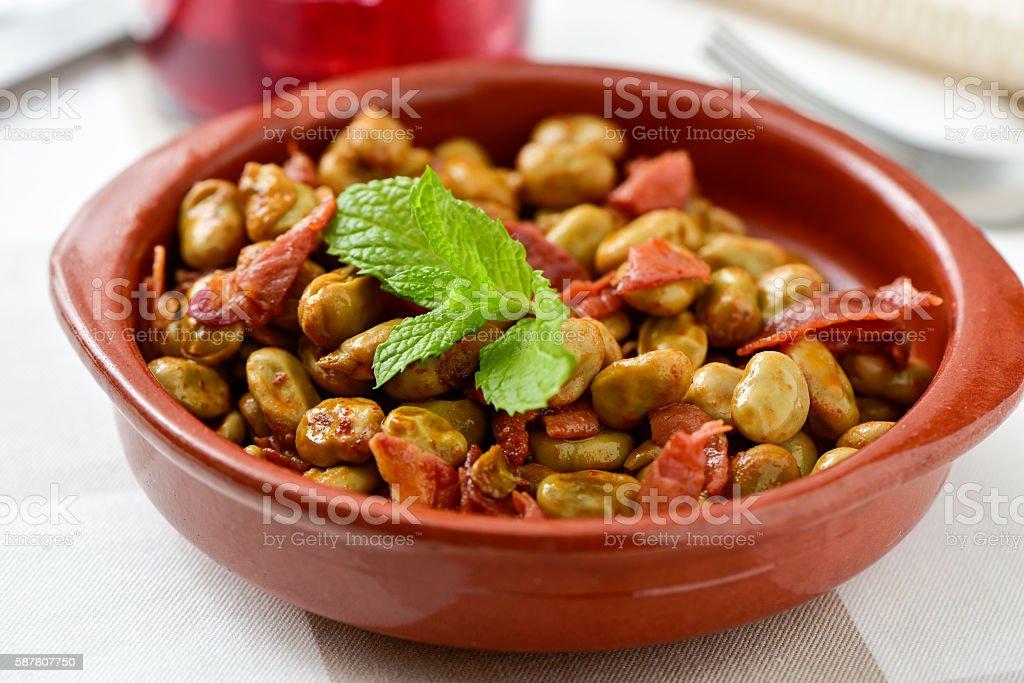 spanish broad bean stew with serrano ham stock photo