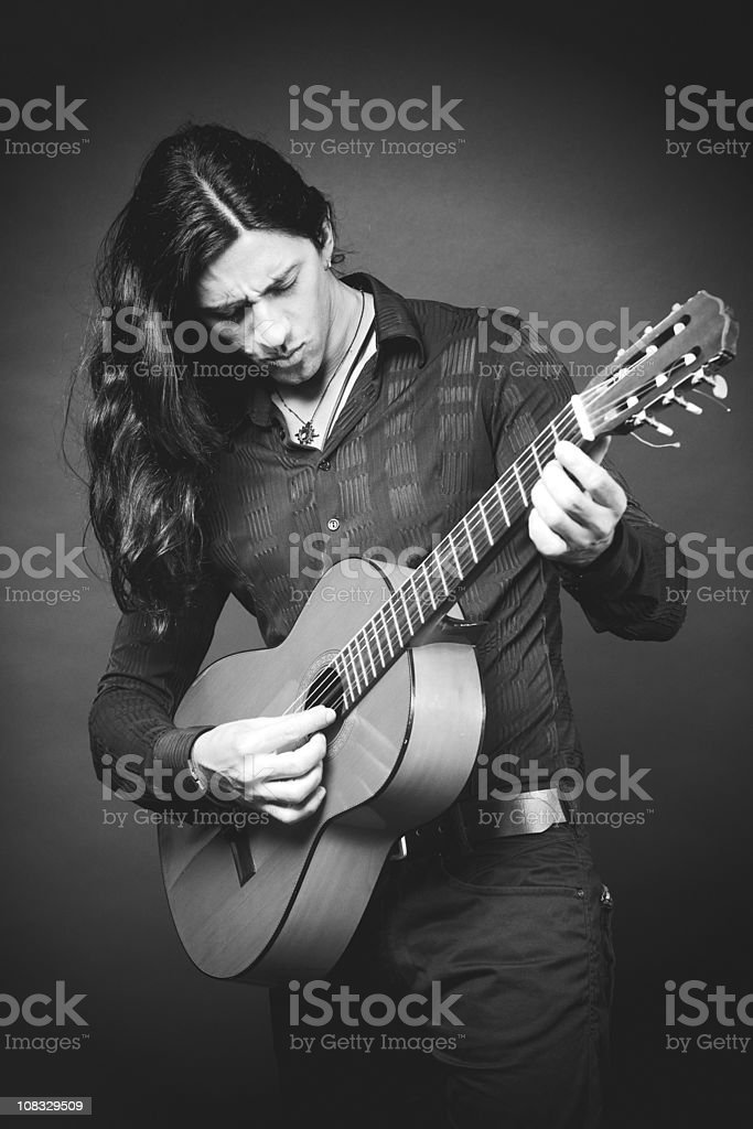 Spanish classic guitar player _ Vertical black and white stock photo