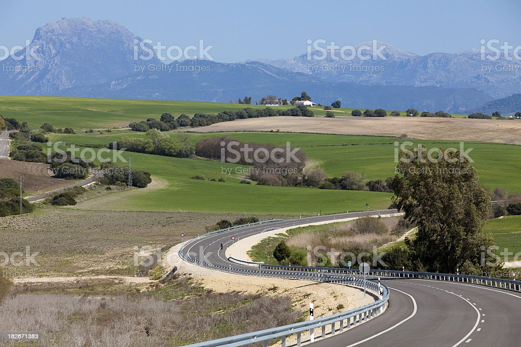 Spanish countryside and winding road stock photo