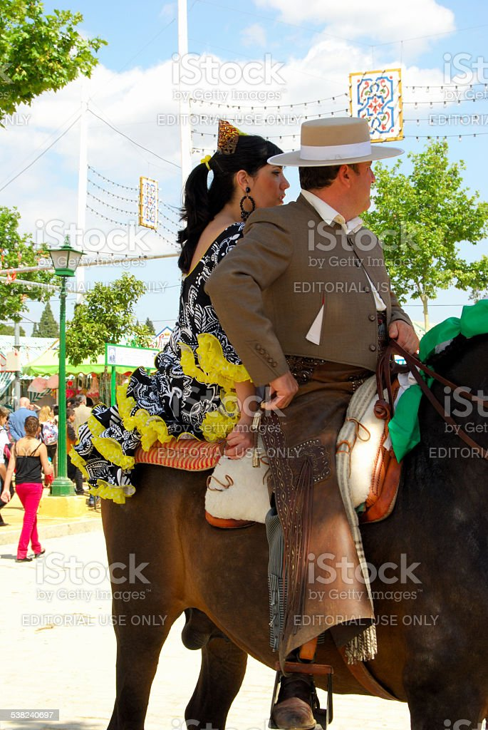Spanish couple on a horse. stock photo