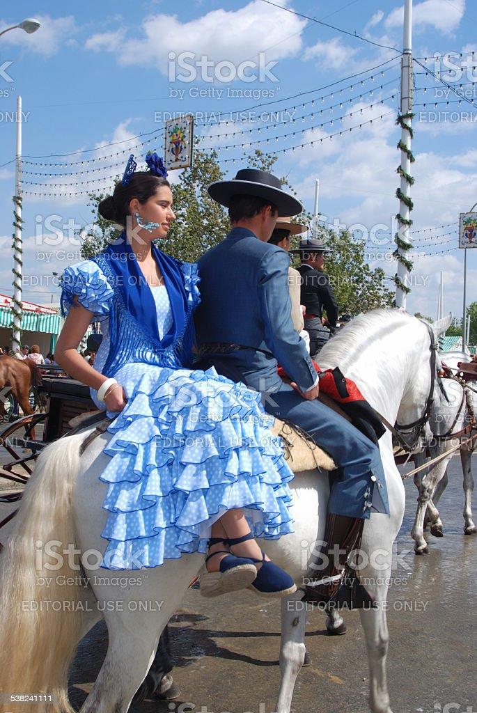 Spanish couple on a horse, Seville. stock photo