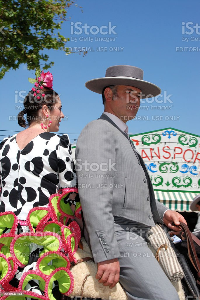 Spanish couple on a horse, Seville, Spain. stock photo