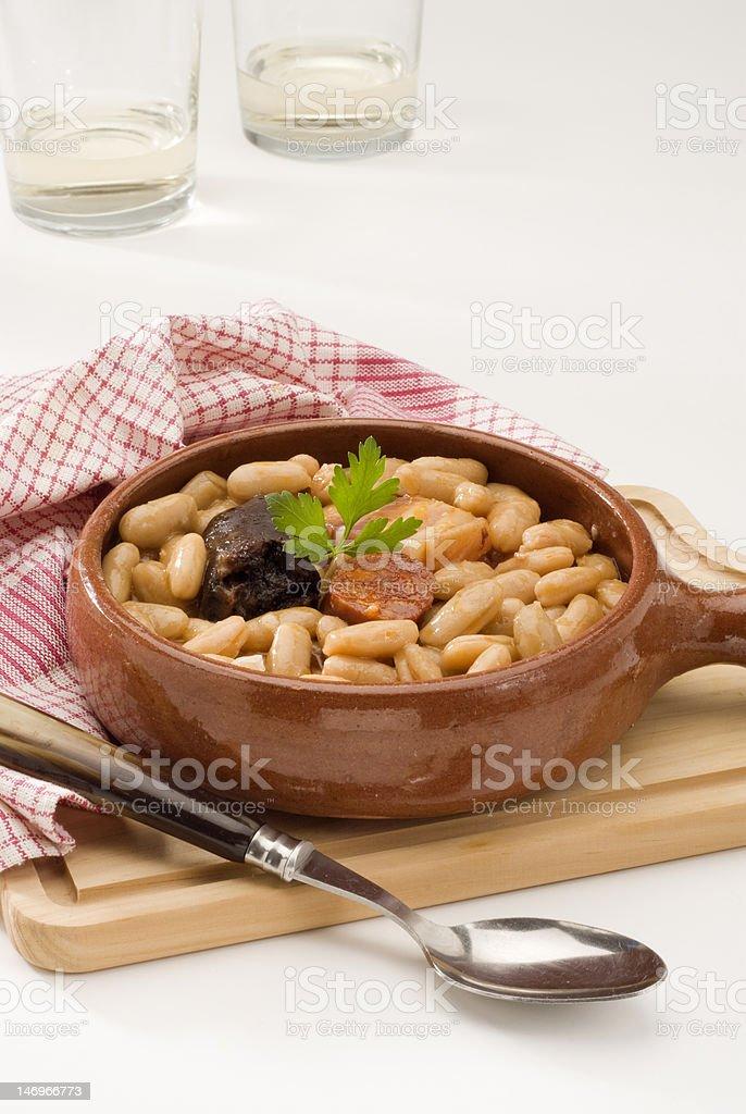 Spanish Cuisine. Asturian ham and beans. stock photo