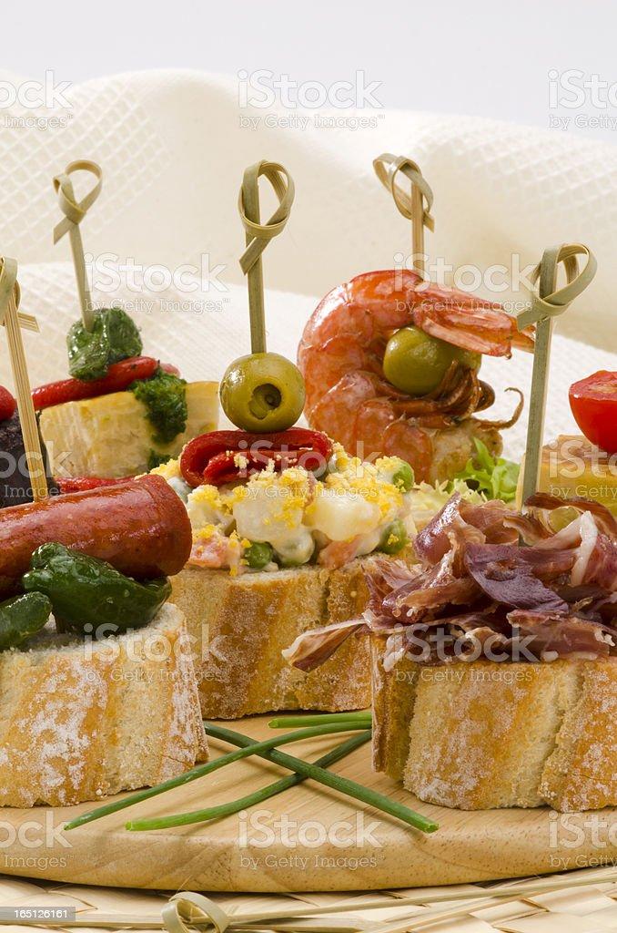 Spanish Cuisine. Tapas. Tray of montaditos. royalty-free stock photo