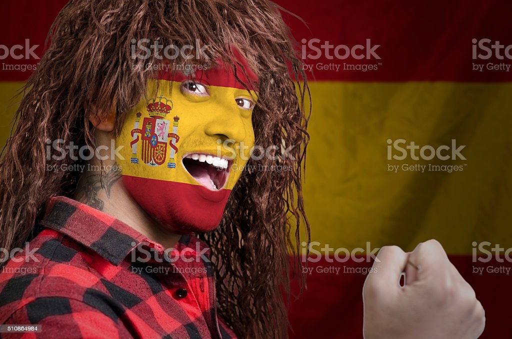 Spanish fan with face painted stock photo