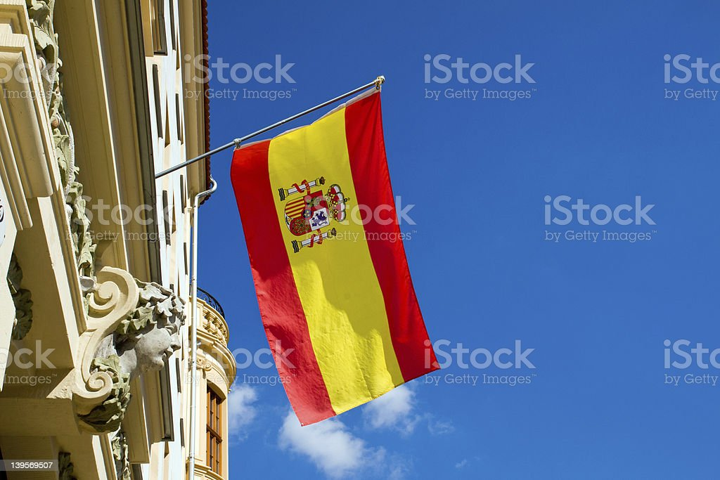 Spanish flag flying at an old building royalty-free stock photo