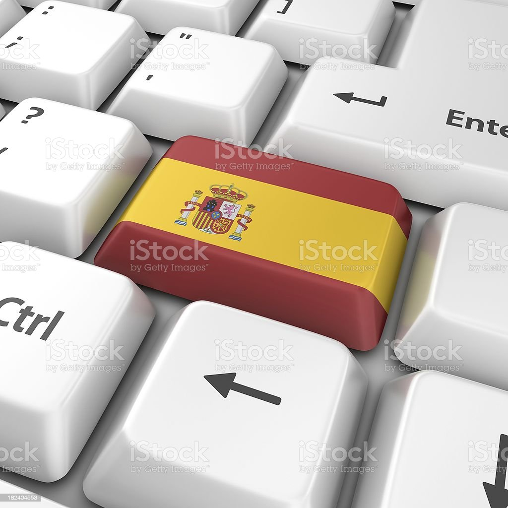 spanish flag on computer key royalty-free stock photo