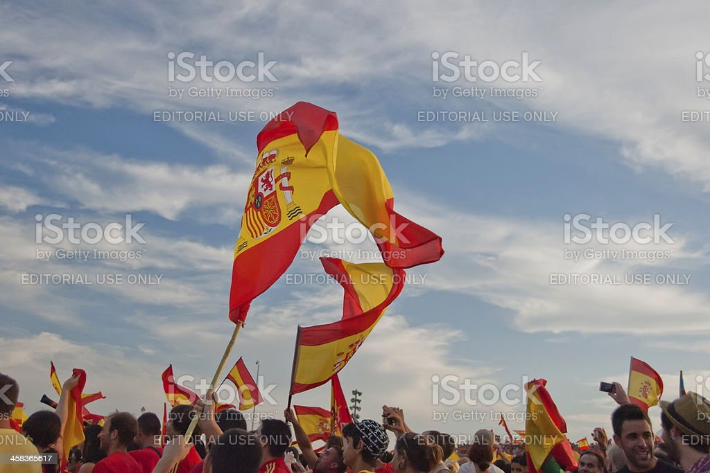 Spanish flags flutter above unidentified fans. stock photo