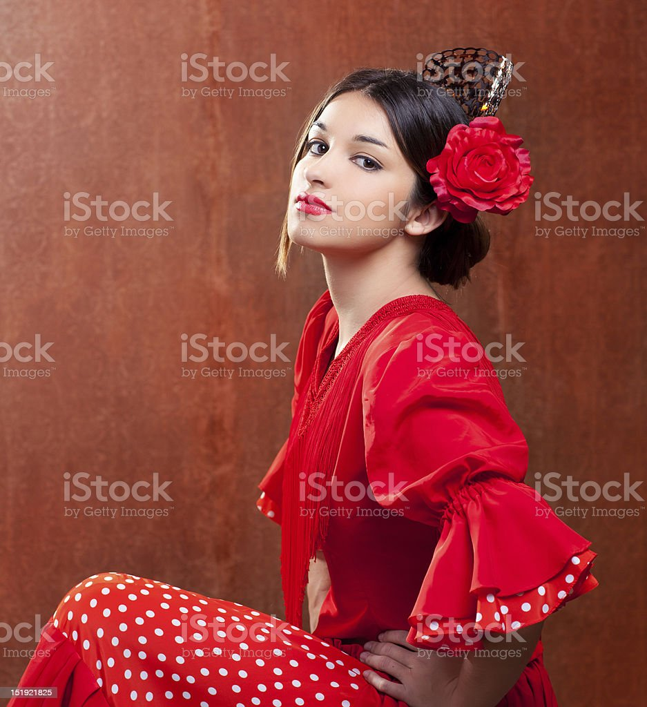 Spanish flamenco dancer with red rose in hair and red outfit stock photo