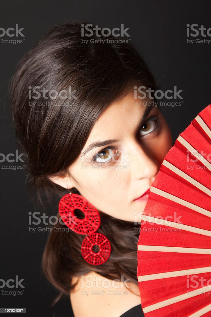 Spanish flamenco looking upwards with a sensual glance stock photo