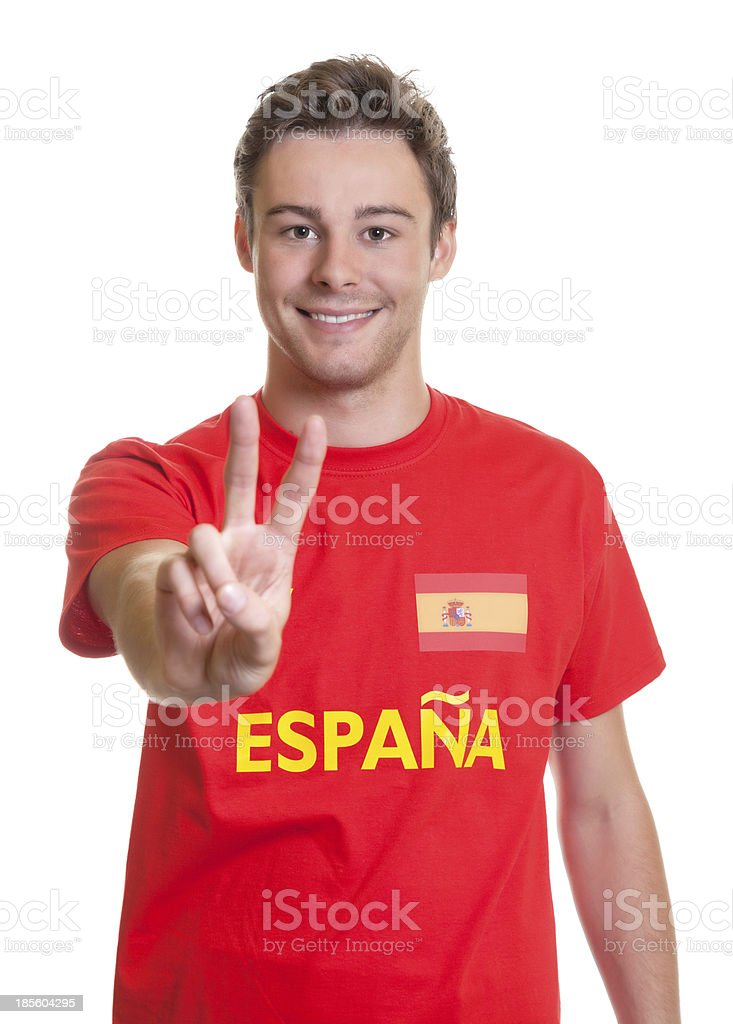 Spanish football fan showing victory sign stock photo