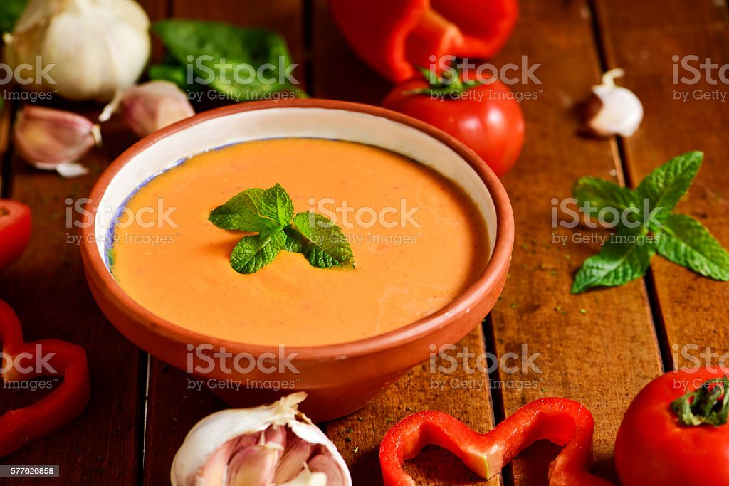 spanish gazpacho on a wooden table stock photo