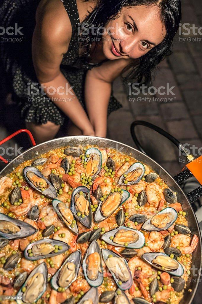 Spanish Girl Cooking Paella stock photo