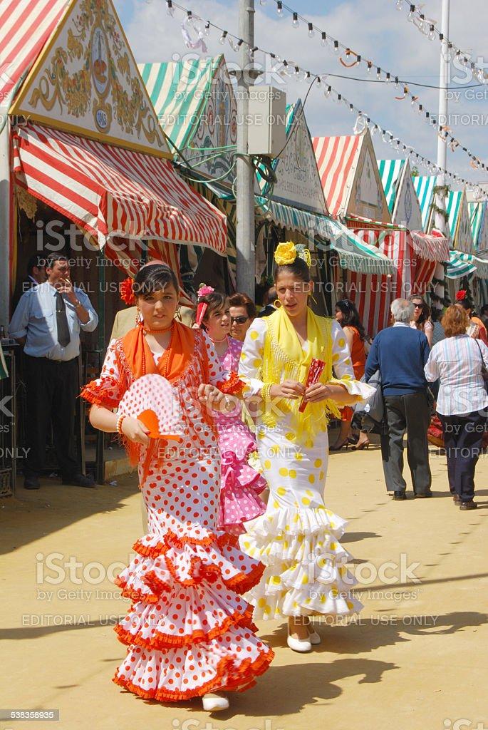 Spanish girls in flamenco dresses. stock photo