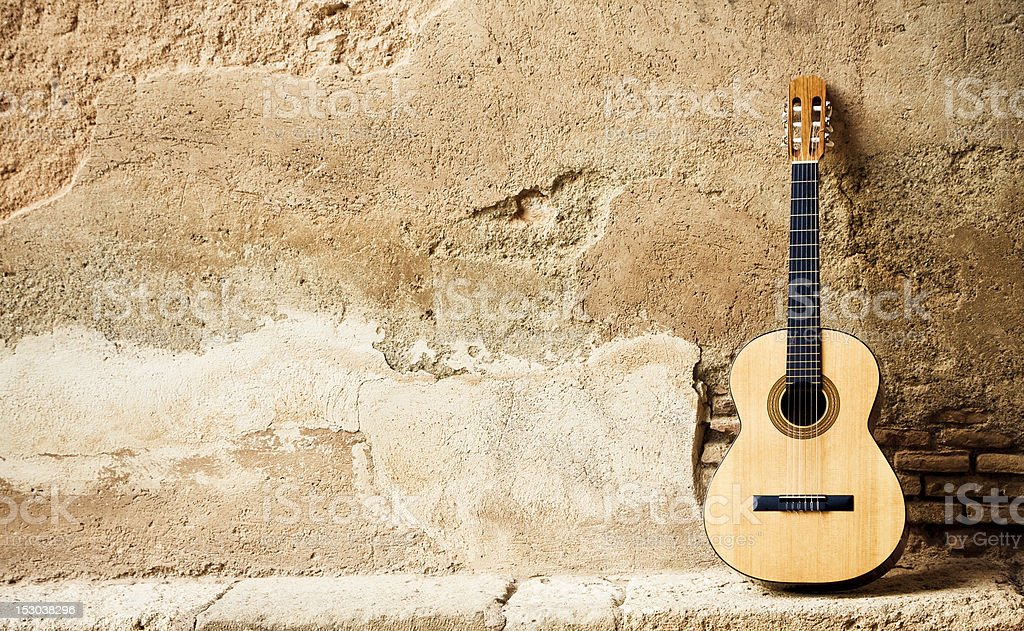 Spanish guitarr on wall stock photo
