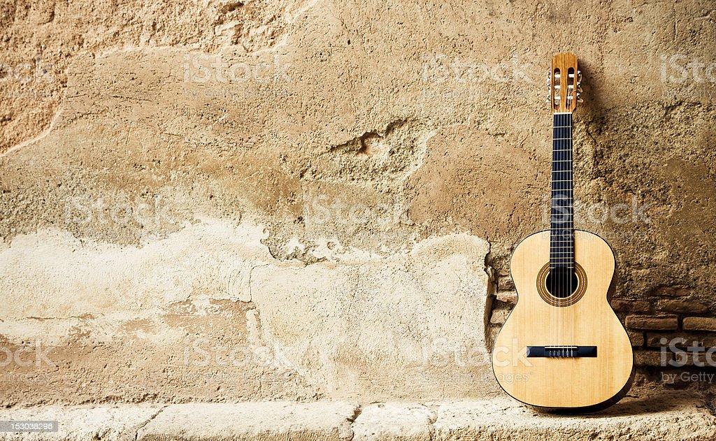 Spanish guitarr on wall stock photo