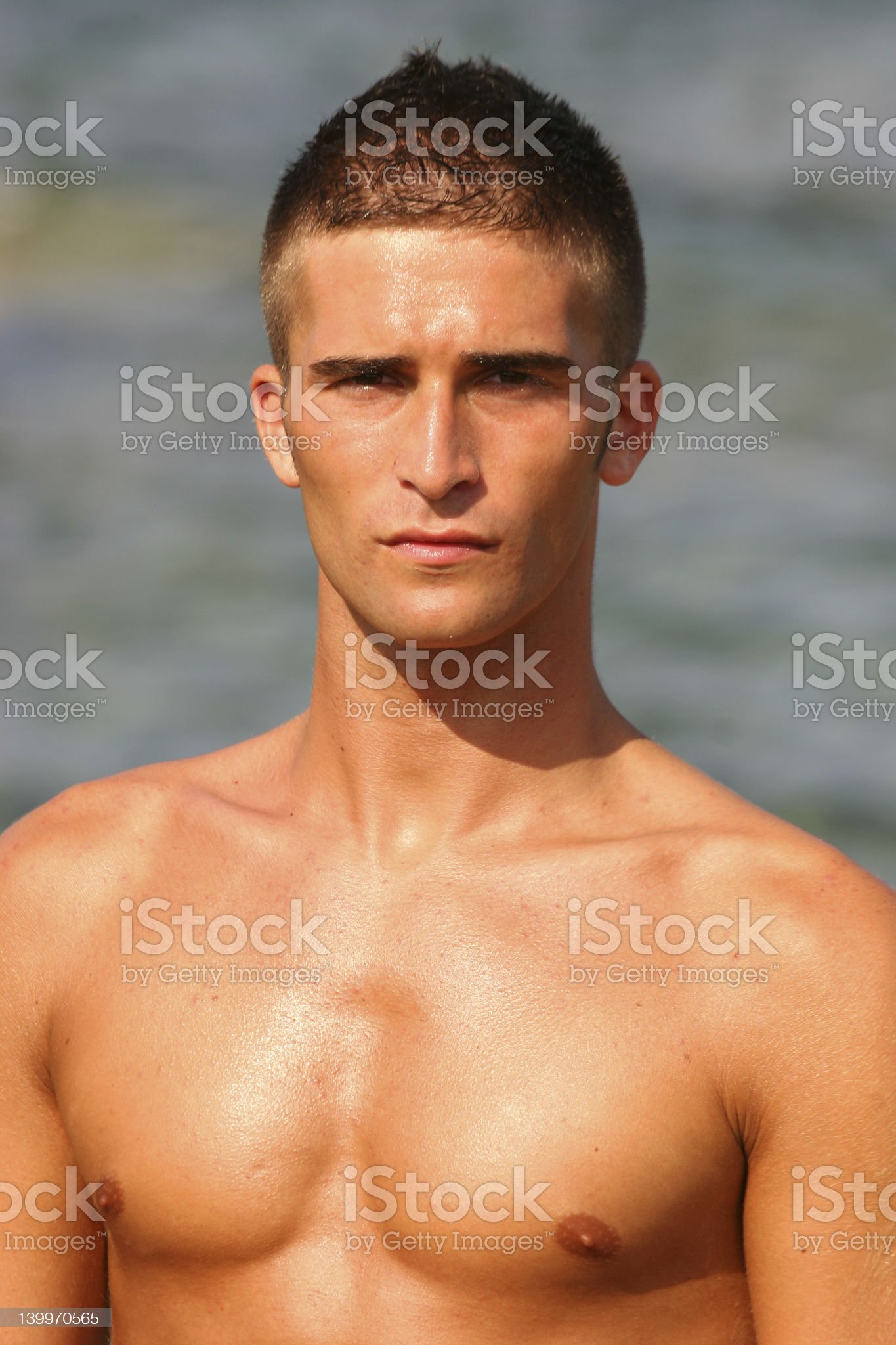 Spanish Guy Standing on Beach Front royalty-free stock photo