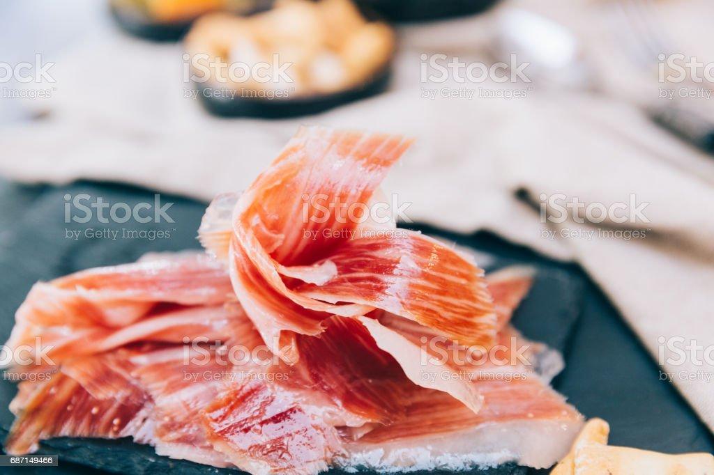 Spanish ham over black board stock photo