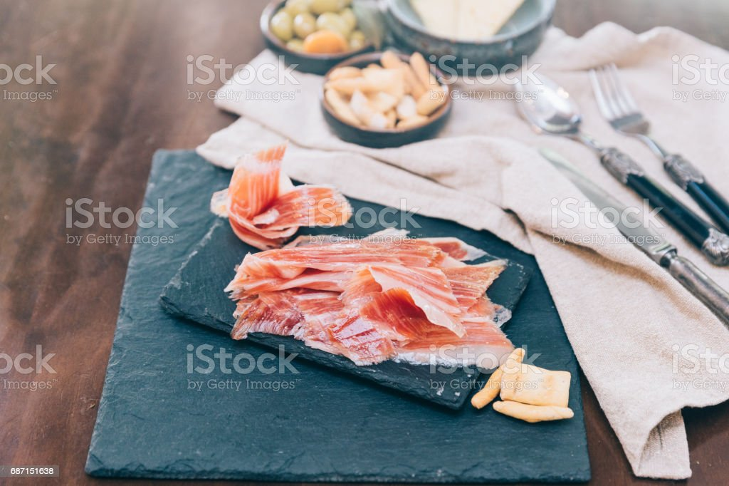 Spanish ham over black booard stock photo