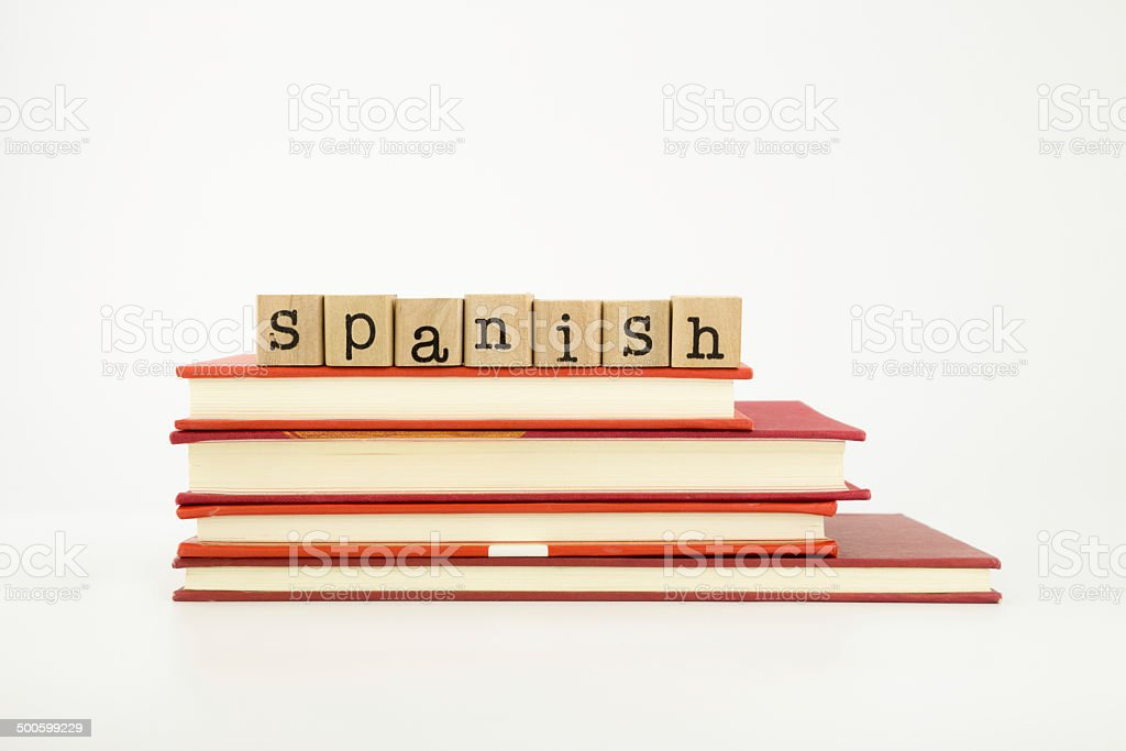 Spanish language word on wood stamps and books stock photo