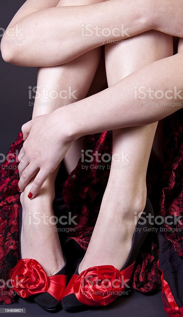 Spanish legs with red and black shoes. royalty-free stock photo