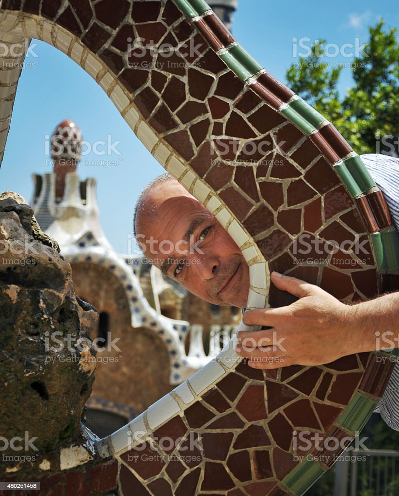 Spanish man in the Park Guell in Barcelona stock photo