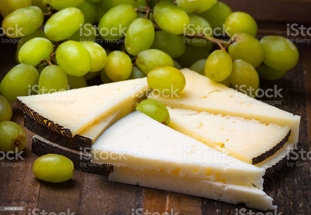 Spanish Manchego Cheese and grapes stock photo