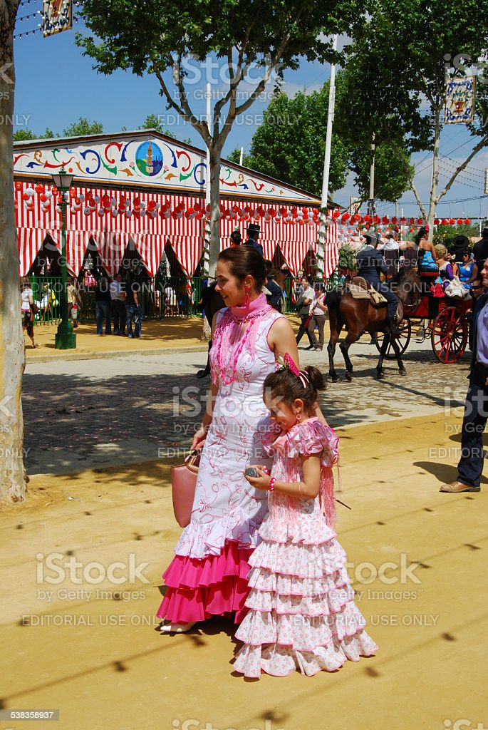 Spanish Mother and Daughter in Flamenco Dresses. stock photo
