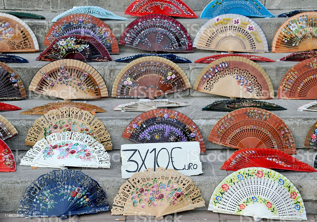 Spanish multicolored folding fans for sale with price in euro royalty-free stock photo