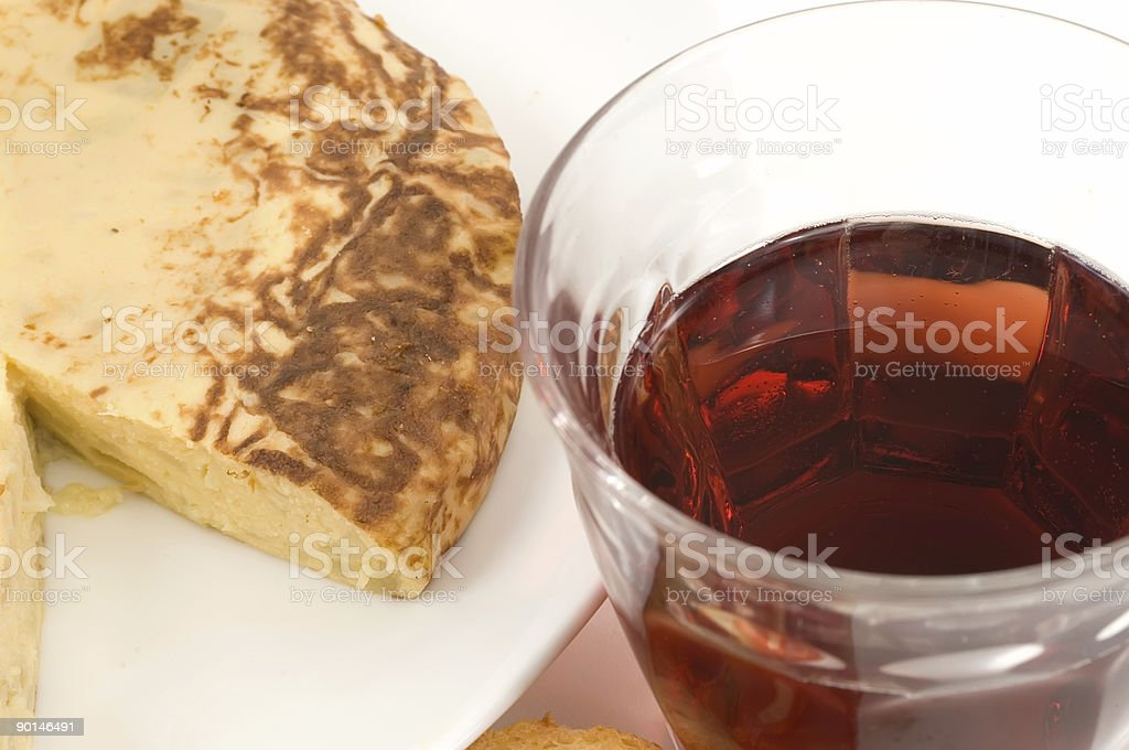 Spanish Omelet and a glass of wine stock photo