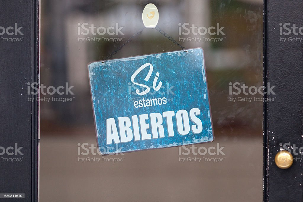 Spanish open sign in a window stock photo
