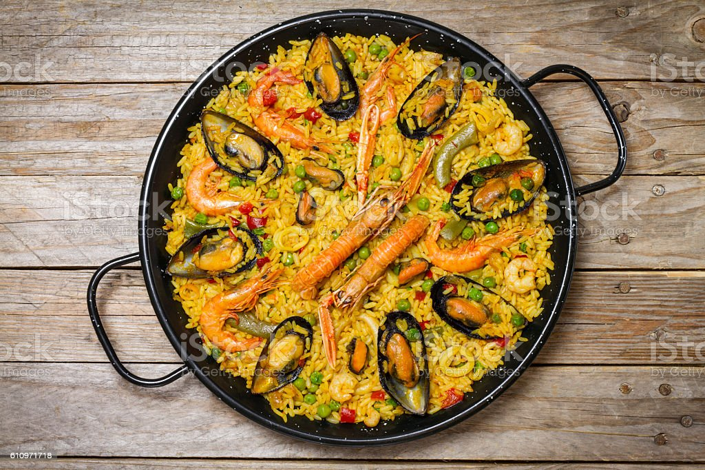 Spanish paella on an antique wooden table