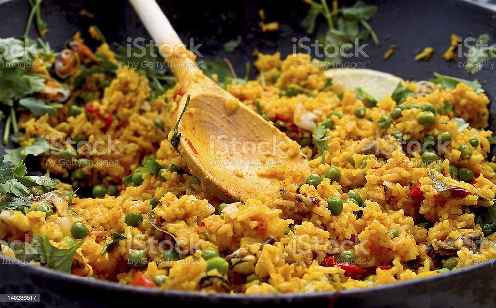 Spanish paella plate being prepared stock photo