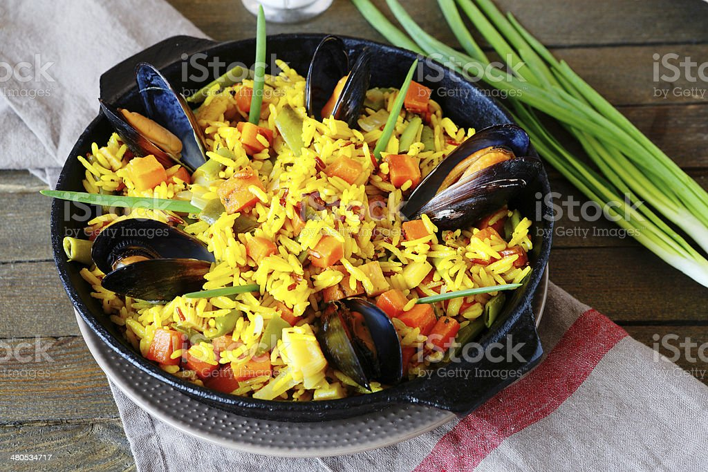 Spanish paella with mussels stock photo