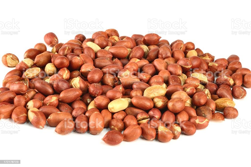 Spanish Peanuts in pile on white royalty-free stock photo