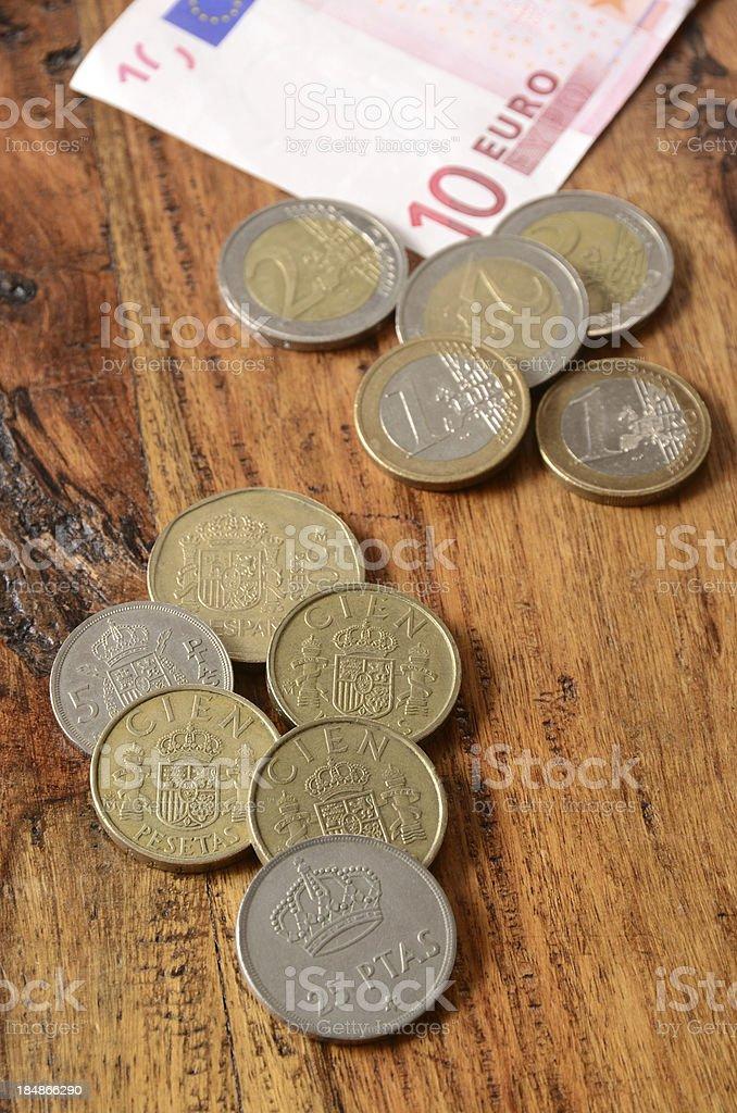 Spanish Pesetas and Euros stock photo