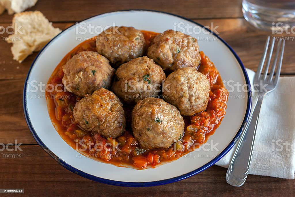 Spanish pisto (typical vegetables stew) with meatballs stock photo