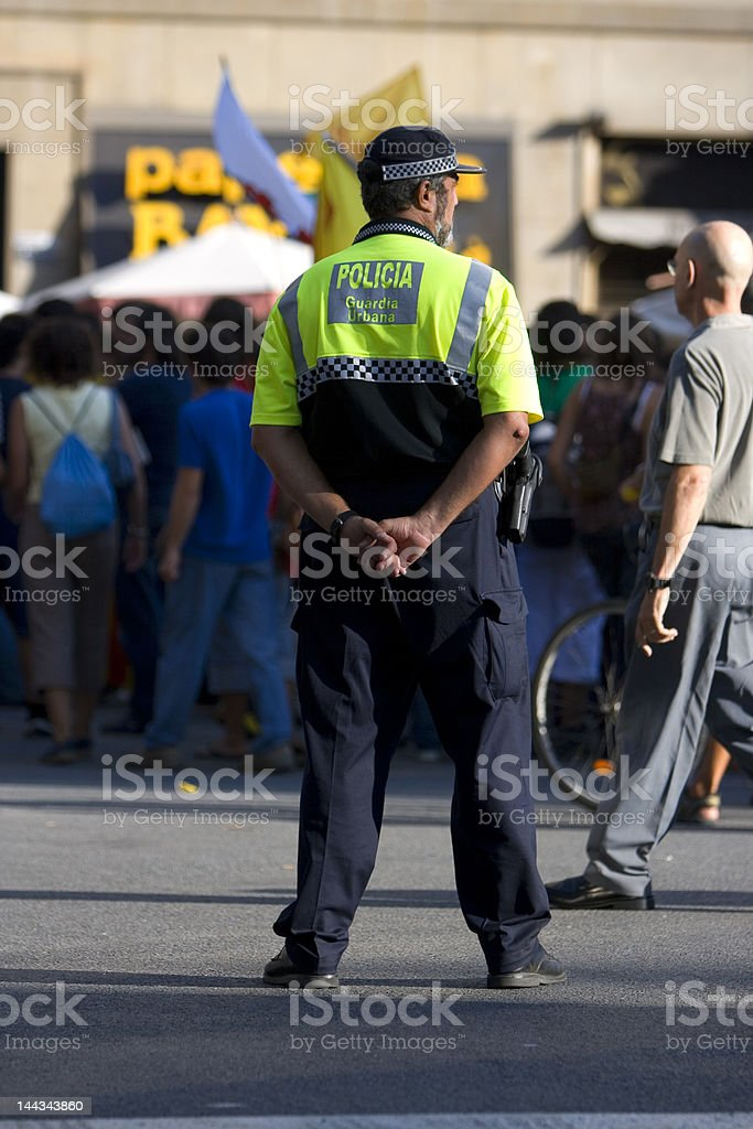 Spanish Policeman looking the mass royalty-free stock photo