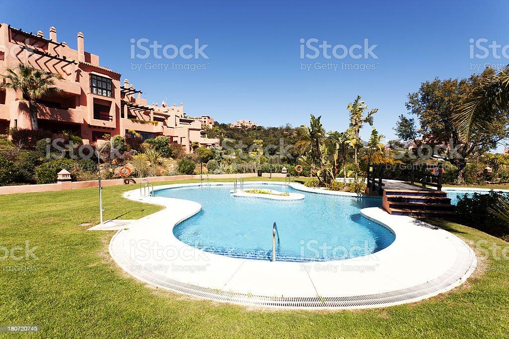 Spanish poolside villas stock photo
