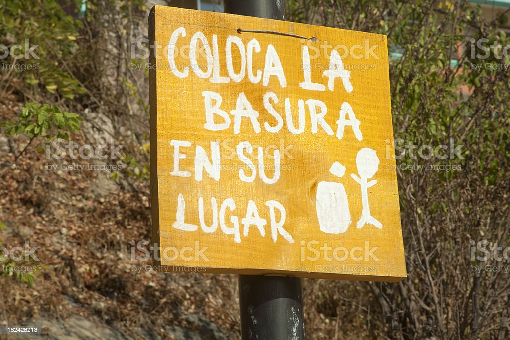 Spanish Sign, Put Litter in Its Place royalty-free stock photo
