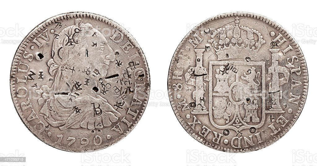 Spanish Silver Doubloon or Pieces of Eight. Close Up, White. stock photo