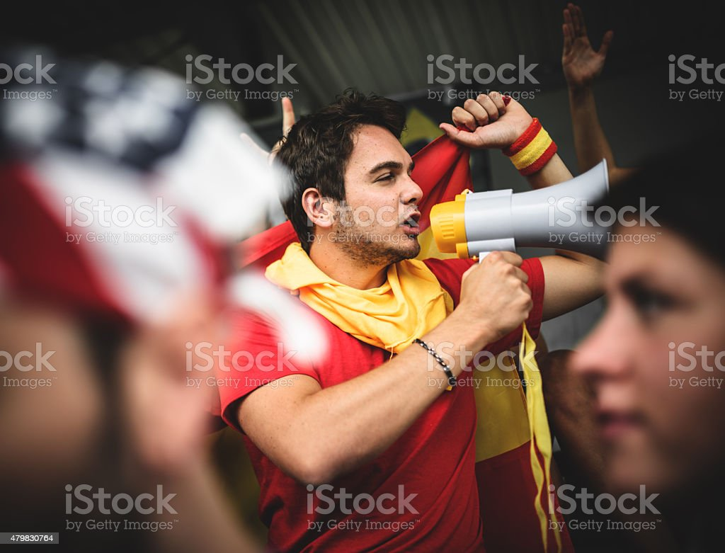 Spanish soccer supporter screaming at the edge of field stock photo