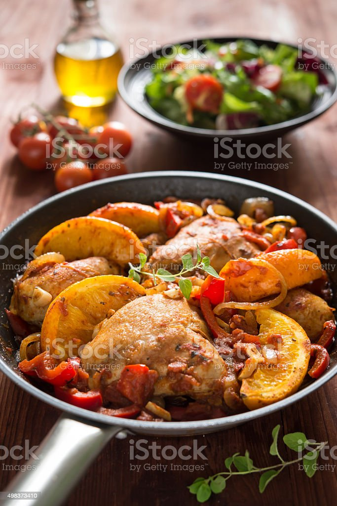 Spanish style chicken with oranges stock photo