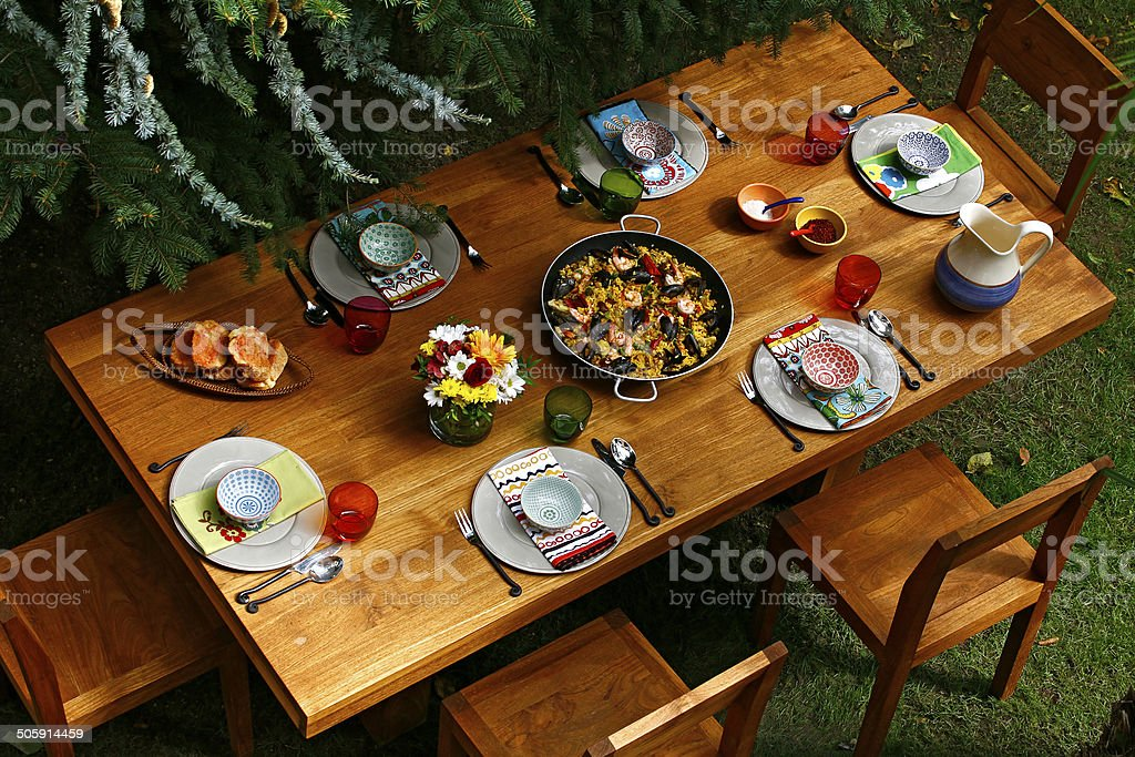 spanish style dining table with paella stock photo