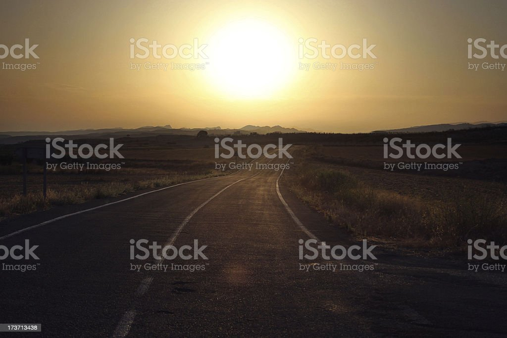 Spanish sunset behind distant mountains stock photo