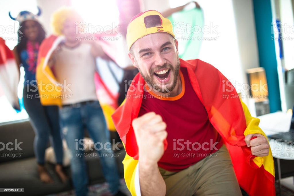 spanish supporter at home looking the tv stock photo